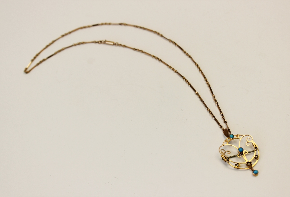 An Edwardian turquoise and seed pearl set pendant/brooch, the unmarked yellow metal open work - Image 3 of 5