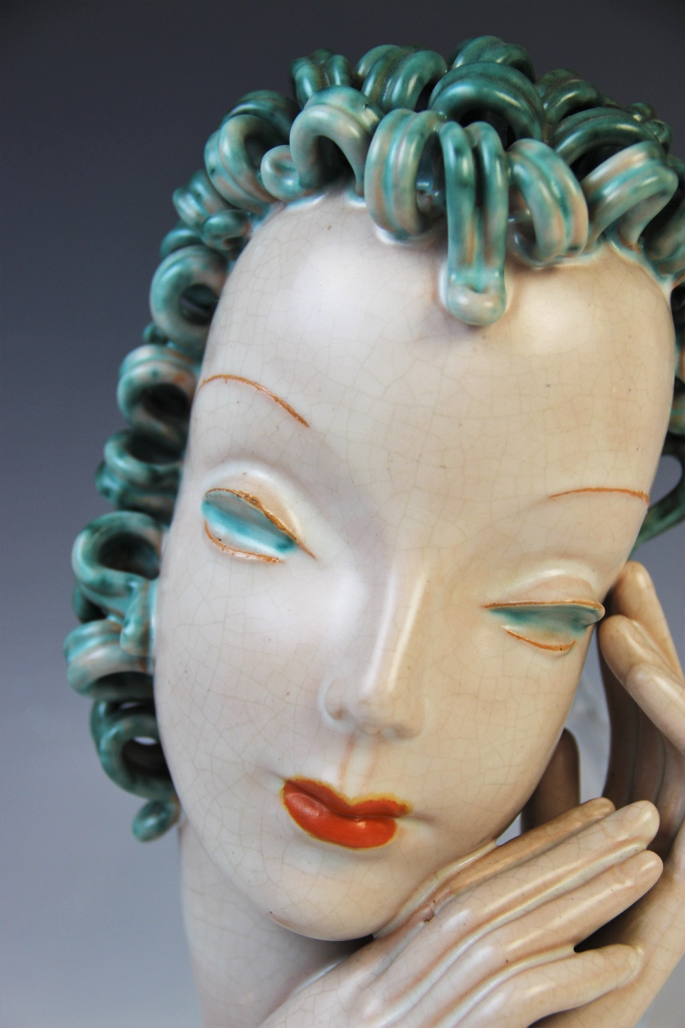 An Art Deco Goldscheider wall mask, early 20th century, modelled as a lady with blue curled hair and - Image 4 of 9