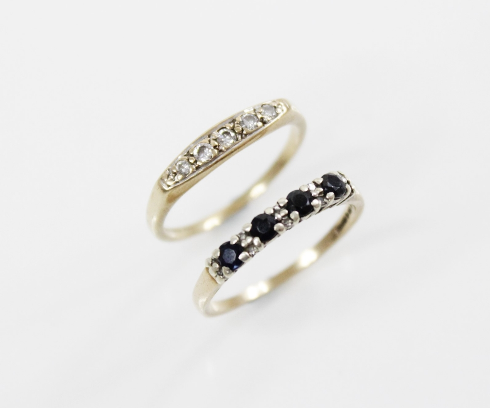 A diamond 9ct boat ring, comprising five round brilliant cut diamonds (total diamond weight of 0.
