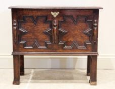 A 17th century style oak coffer bach, late 19th century, the rectangular moulded top above a pair of