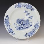 A large Chinese porcelain charger, 18th century, of circular form and decorated with floral