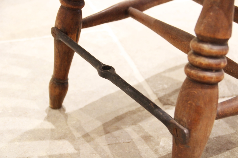 A Victorian elm and beech wood Windsor farmhouse elbow chair, the curvilinear lath back over a - Image 3 of 3