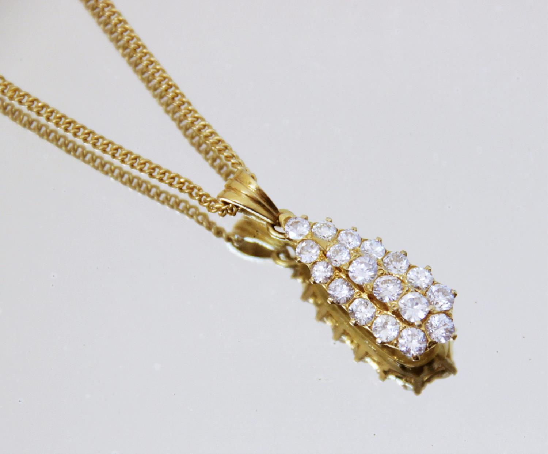 A diamond teardrop pendant, comprising eighteen round brilliant cut diamonds, (estimated diamond