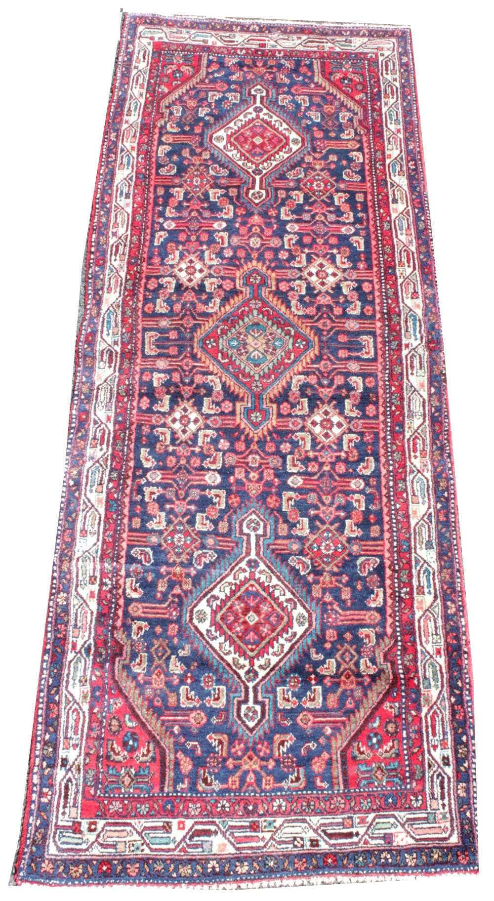 A rich blue ground full pile Iranian runner, with medallion design, 303cm x 110cm