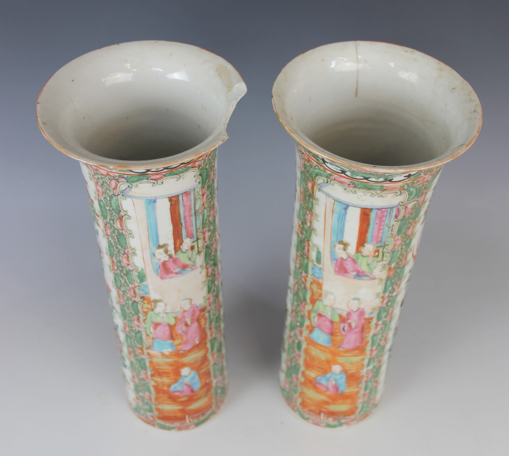 A pair of Chinese Canton vases, 19th century, each of cylindrical sleeve form and decorated in - Image 2 of 4