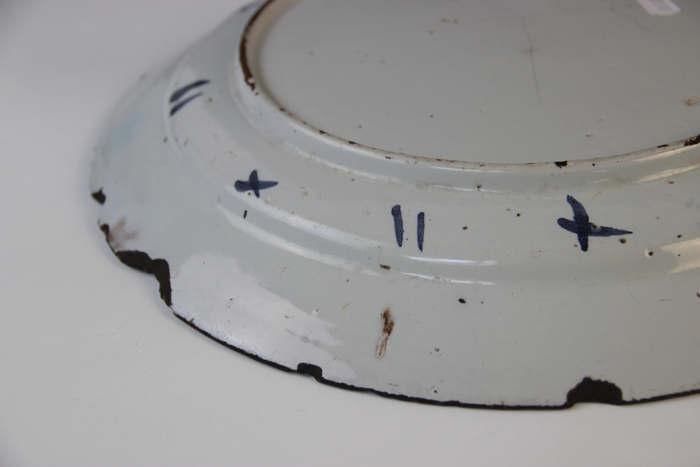 A Delft ware charger, 18th century, the tin glazed earthenware charger of circular form, the central - Image 3 of 6