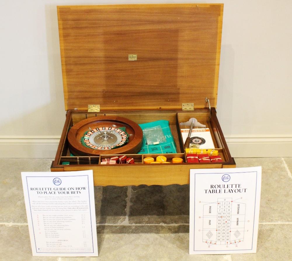 A late 20th century Dal Negro roulette table compendium, the burr walnut quarter veneered table