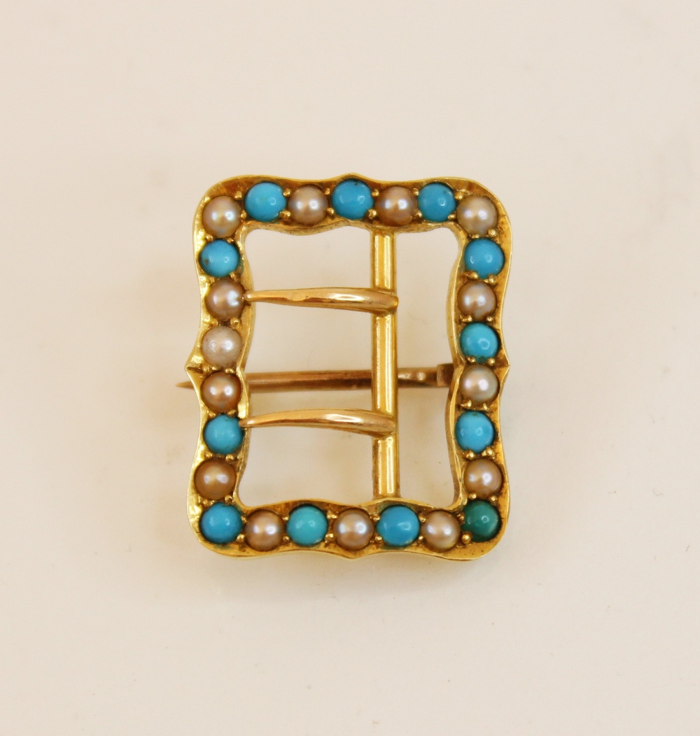 An Edwardian 15ct gold turquoise and pearl buckle brooch, of rectangular form with shaped borders,