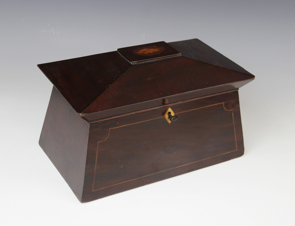 A George III mahogany tea caddy, of sarcophagus form , the pagoda shaped hinged cover centred with - Image 2 of 3