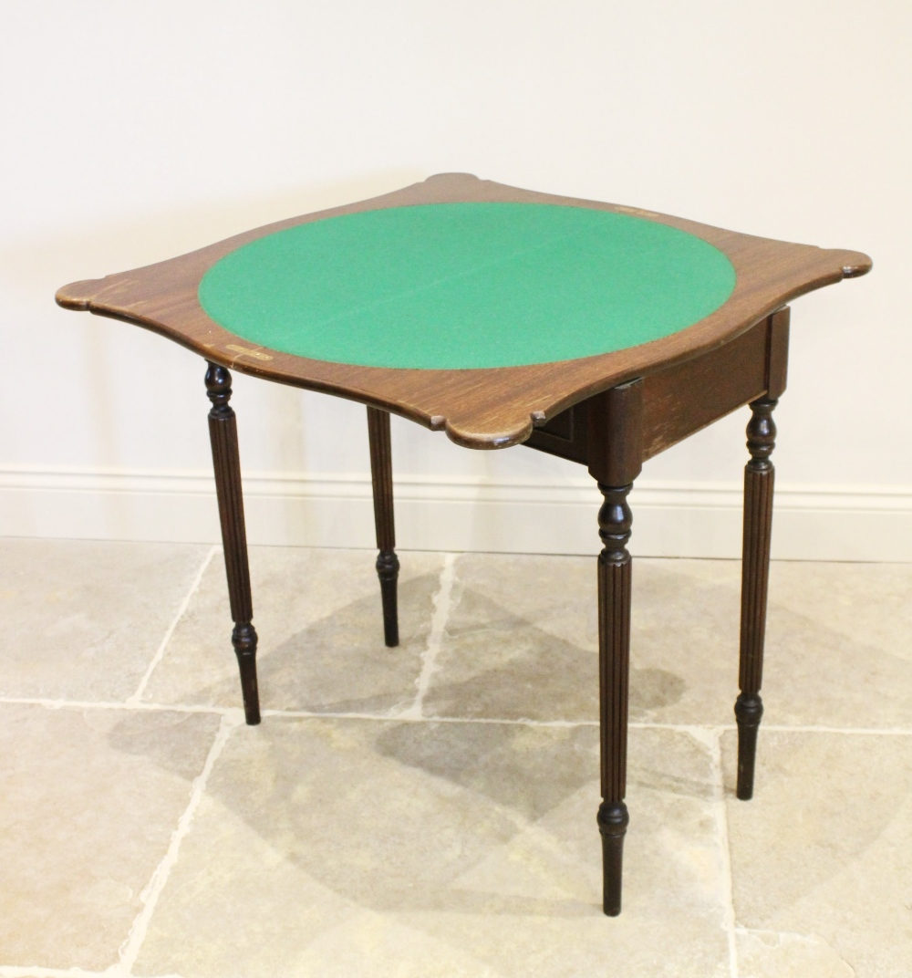 A George III style mahogany games table, late 20th century, the serpentine folding top opening to - Image 3 of 3
