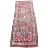 A thick pile deep ground Iranian runner, with traditional medallion design, 310cm x 123cm