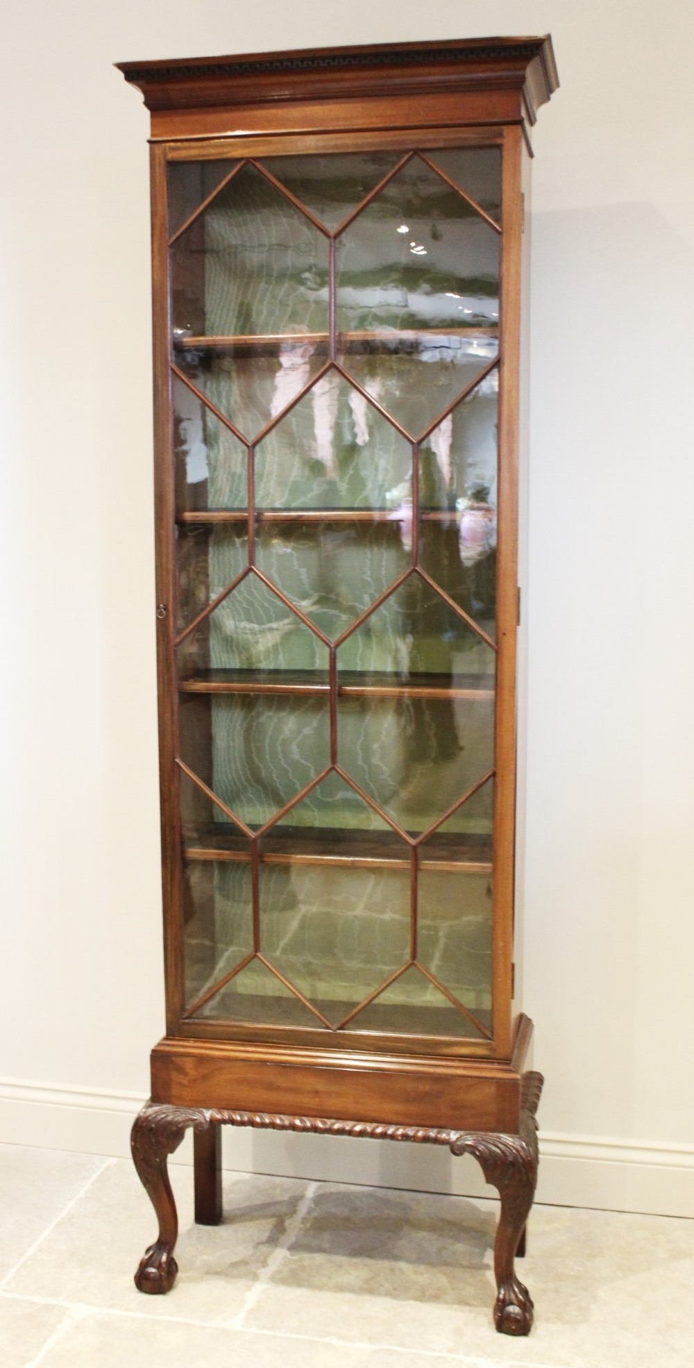 An early 20th century Chippendale revival mahogany display cabinet, with a Greek key pattern