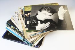 """A collection of thirty vinyl 12"""" LPs, by various artists including Bob Dylan, The Doors, Crosby,"""