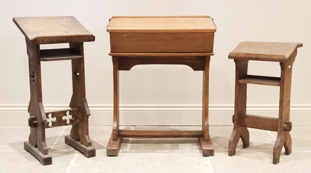A Victorian oak prayer lectern, the angled book rest raised upon trestle type supports, carved