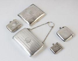 A George V silver purse William Neale, Birmingham 1919, 10.4cm x 6.7cm, together with an Edwardian