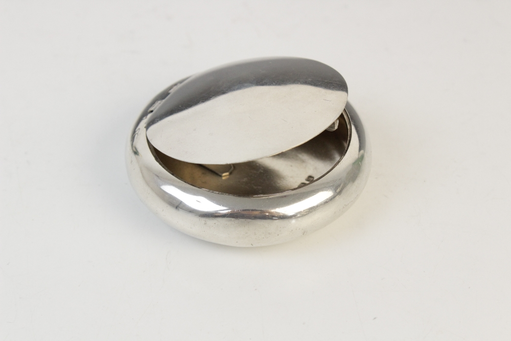 A silver compact by Clark & Sewell, Chester 1942, 7.7cm diameter, together with a silver and - Image 3 of 10