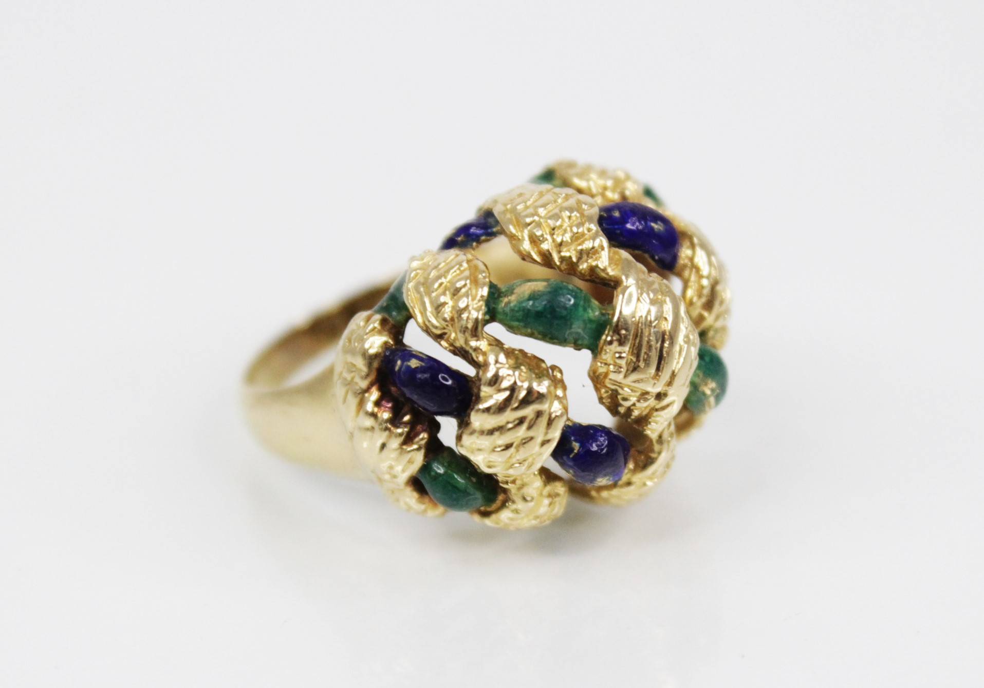 An 18ct gold enamelled 'bombe' ring, the openwork woven design head with textured engraving and blue - Image 3 of 4
