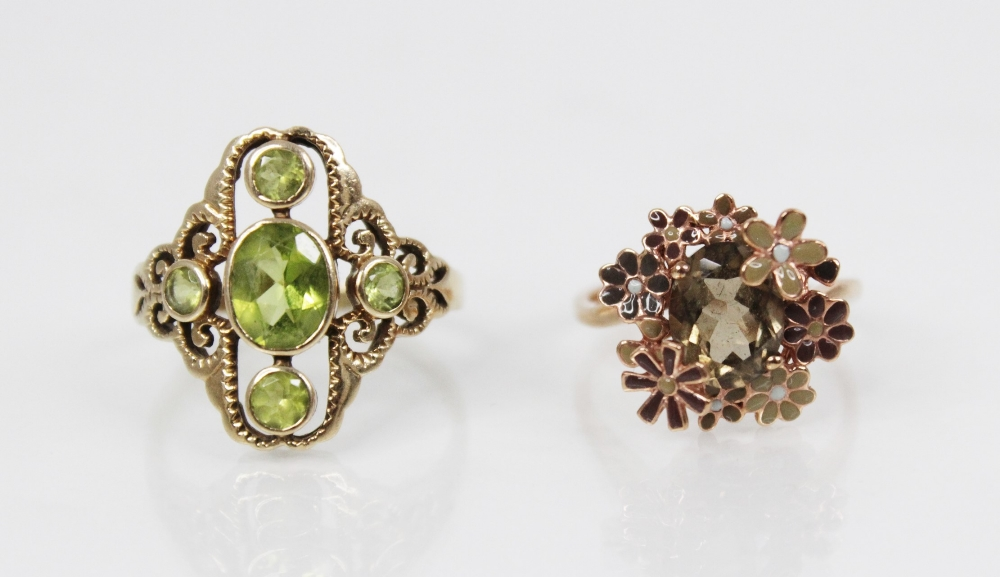 A 9ct gold peridot set dress ring, the central oval mixed cut peridot (measuring 7mm x 6mm),