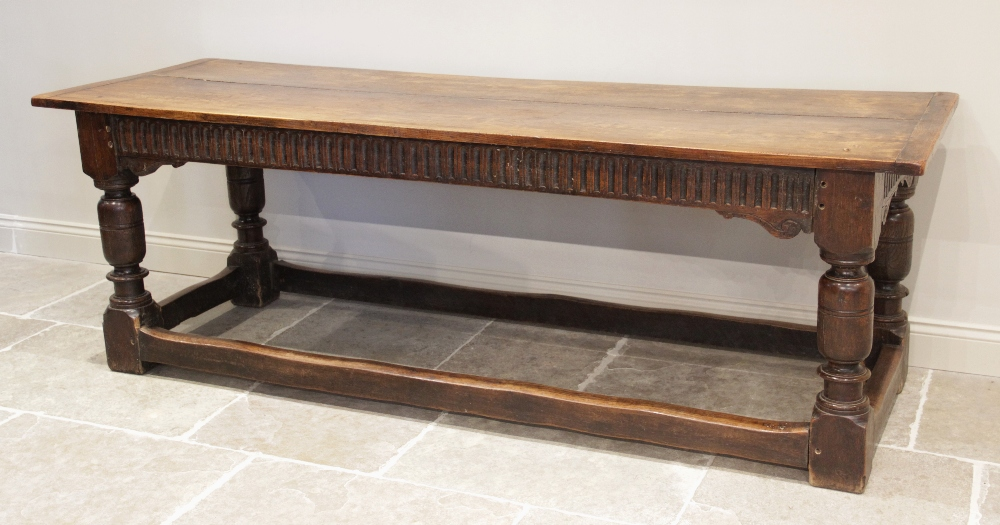 A 17th century and later oak refectory table, the rectangular twin plank cleated top above a