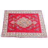 A vintage multi coloured ground Persian Tabriz carpet, bespoke floral design. the central