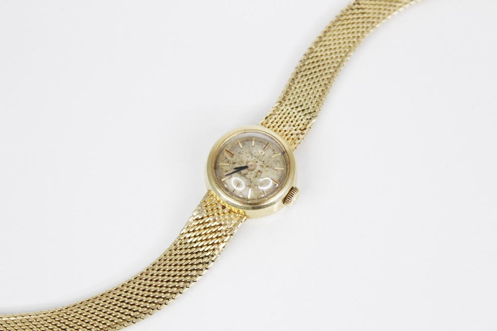 A lady's 14ct gold Omega Ladymatic wristwatch, the circular champagne dial with gold-toned baton