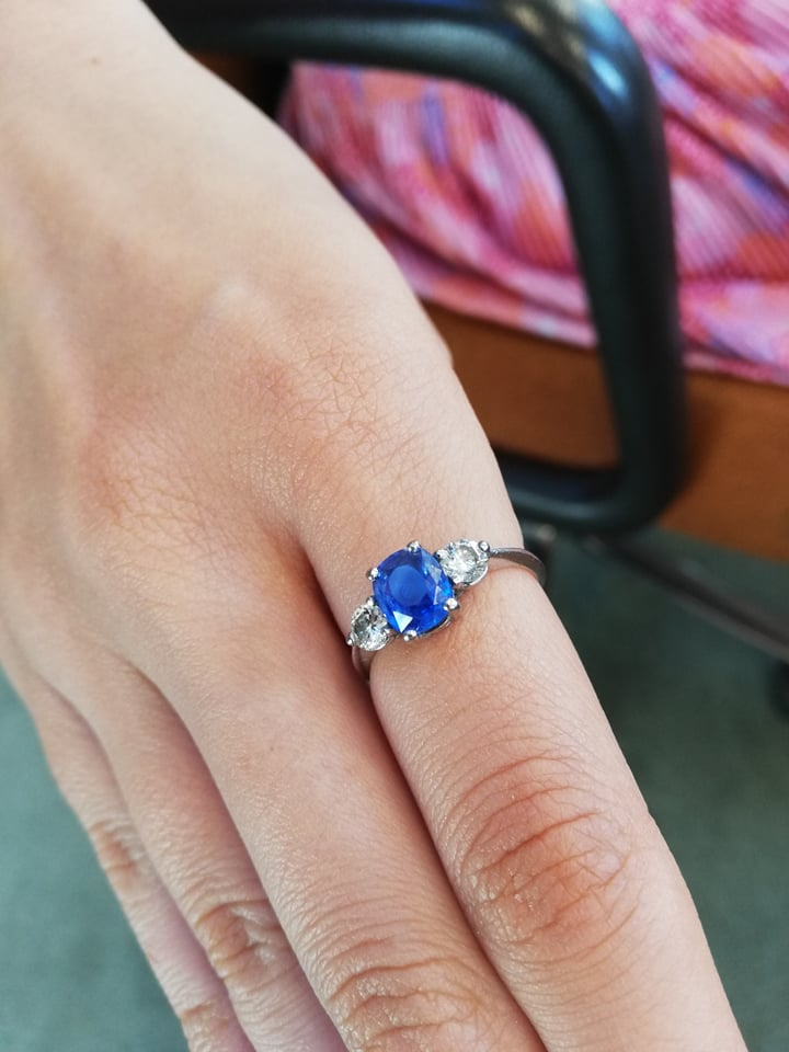 A sapphire and diamond three-stone ring, the (untested) central mixed, cushion cut sapphire ( - Image 8 of 8