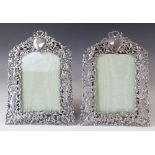 A pair of Victorian silver photograph frames by William Comyns, London 1894, of arched rectangular