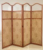 A late 19th century satinwood three fold screen, the four arched sections with a glazed panel over a