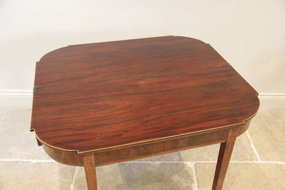 A George III mahogany folding tea table, the shaped top with inlaid satinwood stringing to the edge, - Image 3 of 3