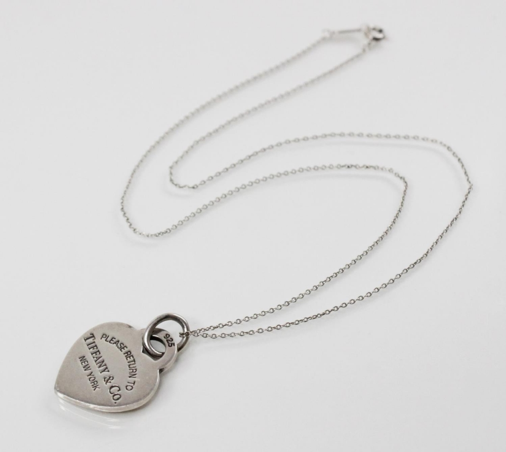 A Tiffany & Co silver heart pendant marked 'Please return to Tiffany & Co. New York', 26mm x 21mm, - Image 3 of 3