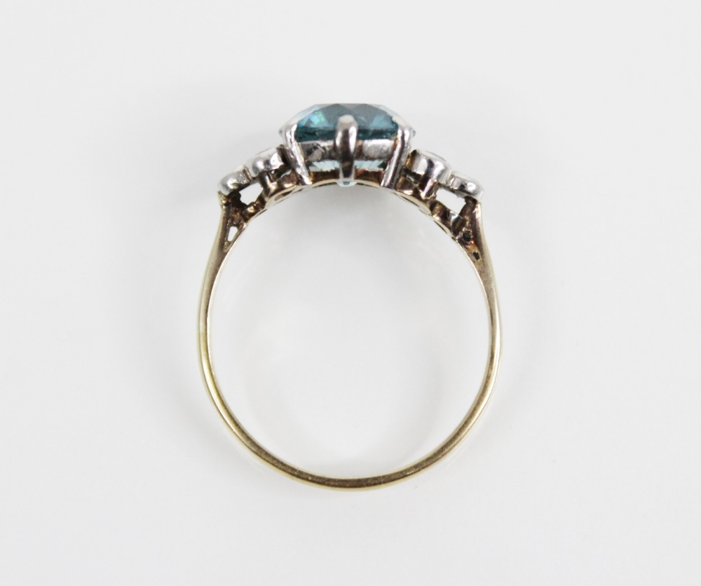 A zircon and diamond ring, the central round mixed cut blue zircon (measuring 8.65mm diameter), - Image 7 of 8