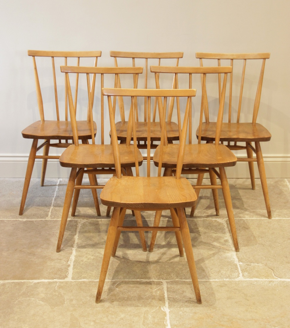 A set of six 1960's Ercol blonde elm and beech wood kitchen chairs, each chair with a stick back