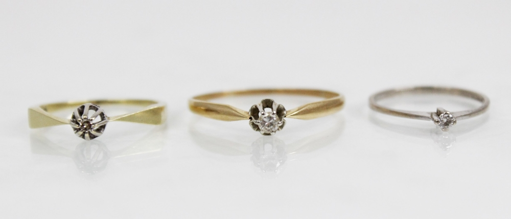 A diamond solitaire ring, the central round brilliant cut diamond (weighing approximately 0.10