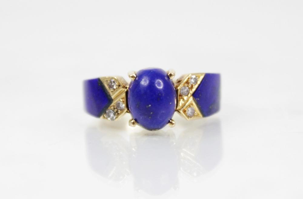 A lapis lazuli and diamond set dress ring, designed as a central polished oval lapis lazuli cabochon