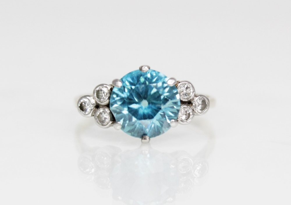 A zircon and diamond ring, the central round mixed cut blue zircon (measuring 8.65mm diameter), - Image 2 of 8