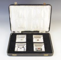 A cased set of four silver dishes, Henry Matthews, Birmingham 1930, each of square form with later