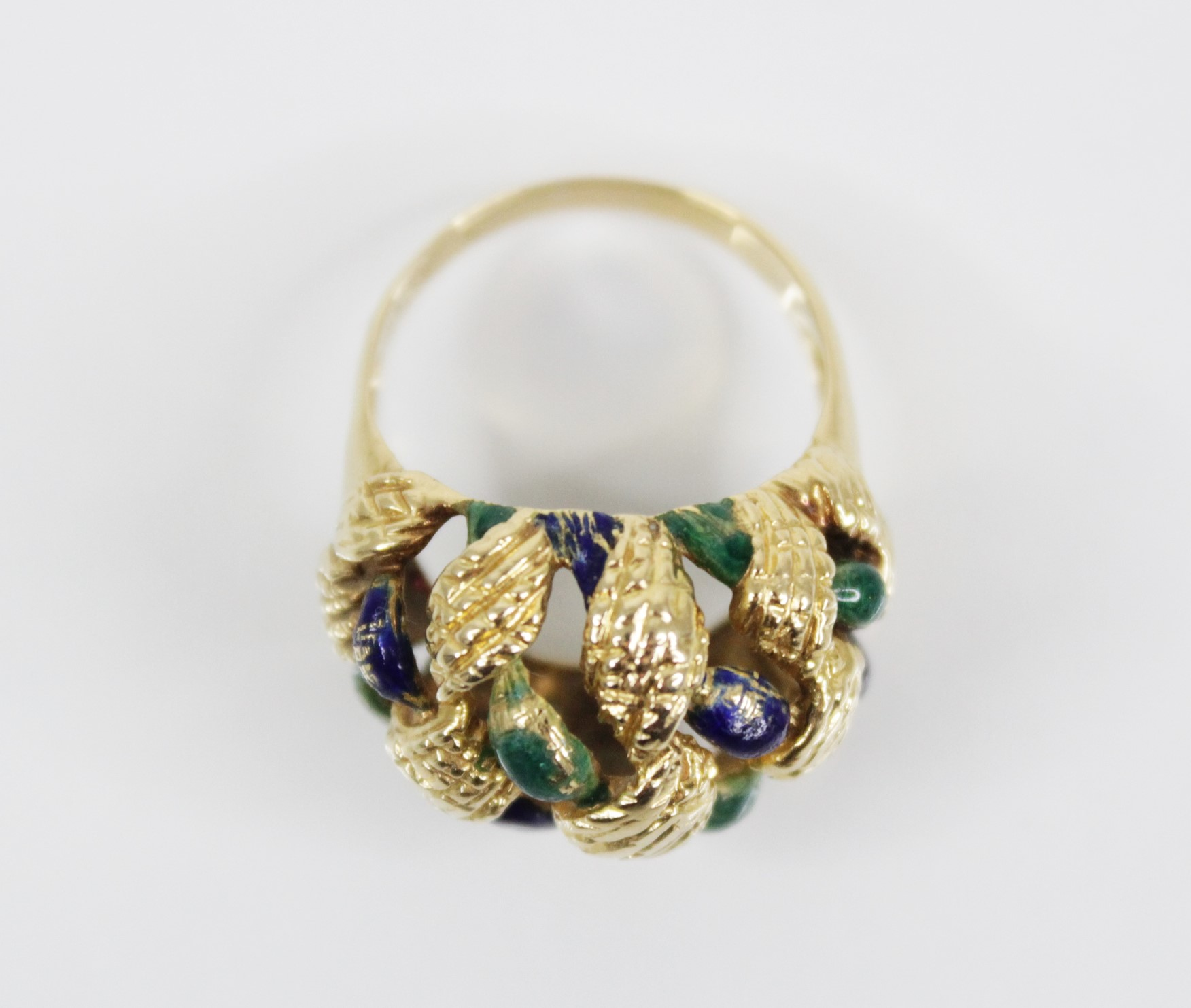 An 18ct gold enamelled 'bombe' ring, the openwork woven design head with textured engraving and blue - Image 2 of 4