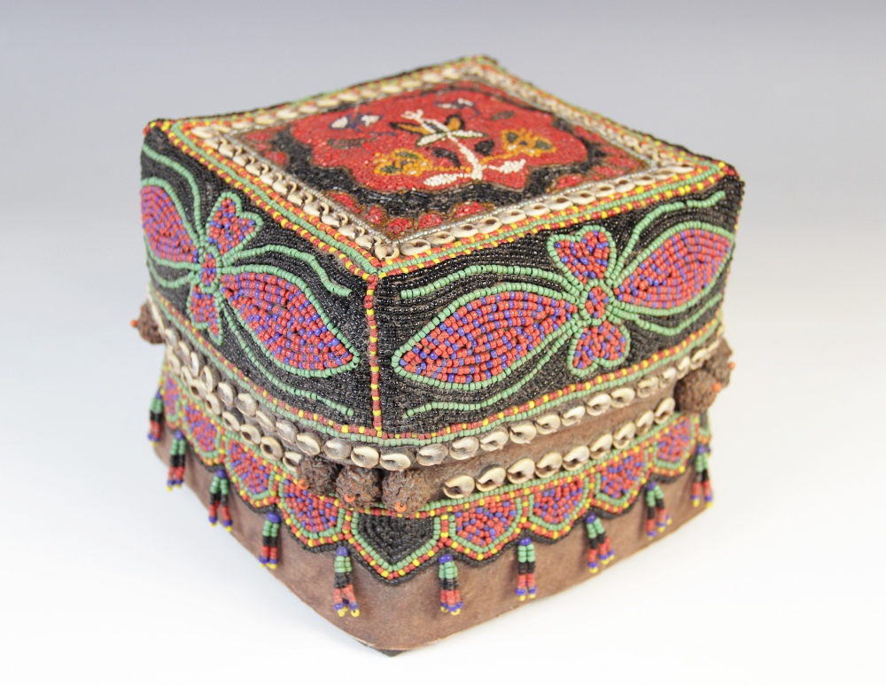 A Sumatran ceremonial wedding box, woven from split bamboo and traditionally decorated with beads,