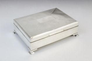 A George V silver cigarette box by W T Toghill & Co, Birmingham 1935, of rectangular form raised