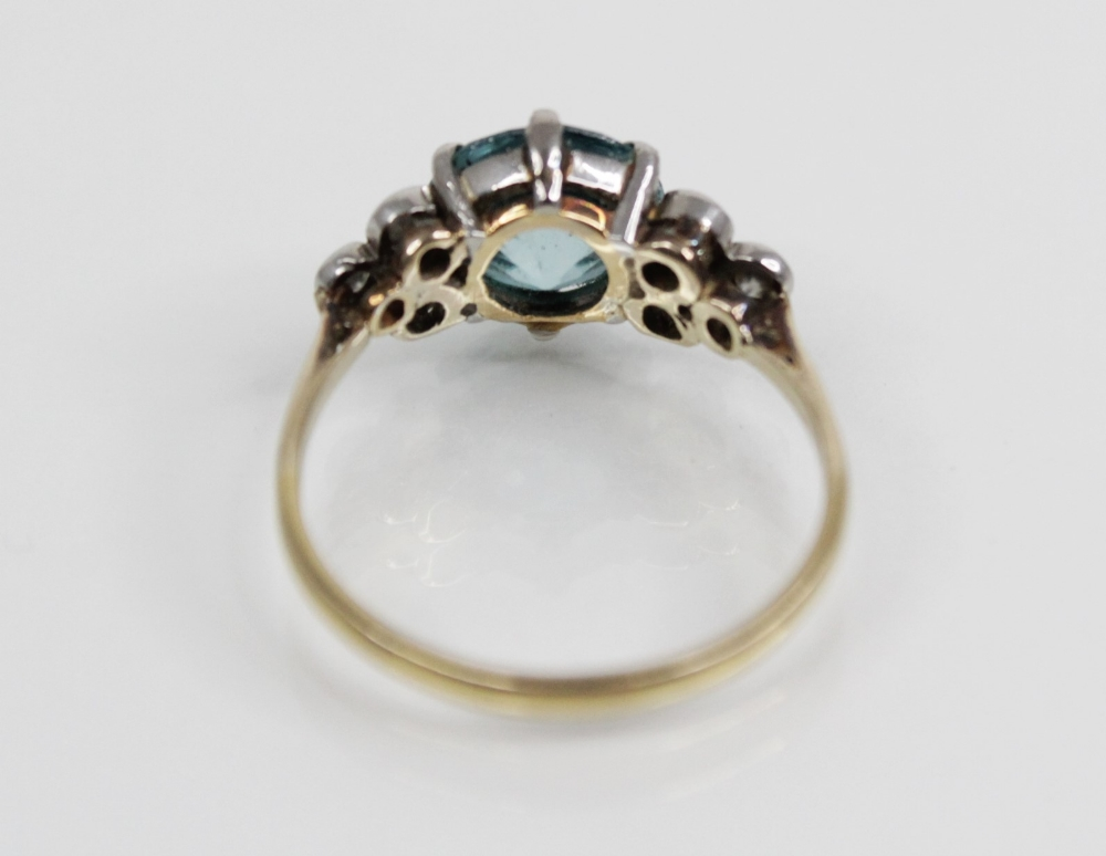A zircon and diamond ring, the central round mixed cut blue zircon (measuring 8.65mm diameter), - Image 8 of 8
