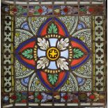 A pair of Victorian trefoil stained glass panels, 19th century, taken from larger church windows,
