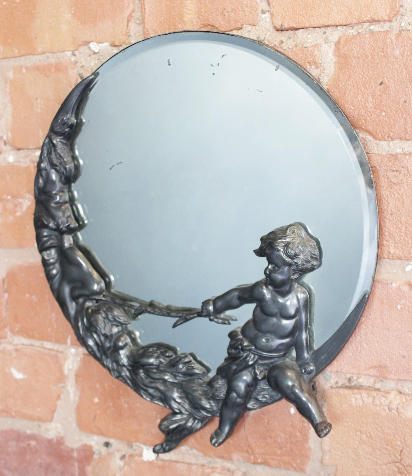 A pewter mounted Art Nouveau circular mirror, late 19th/early 20th century,