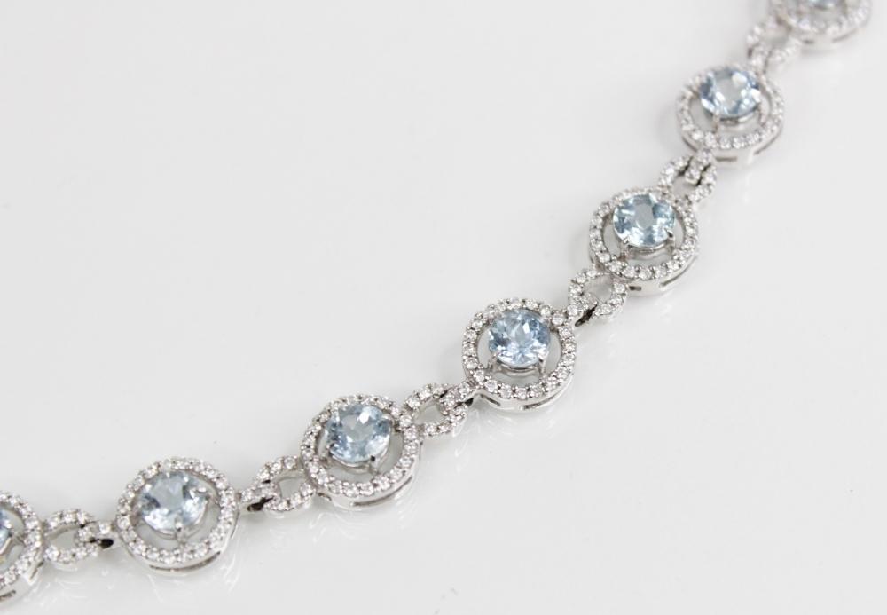 An aquamarine and diamond bracelet, comprising twelve round mixed cut aquamarines, (each 5mm - Image 3 of 4
