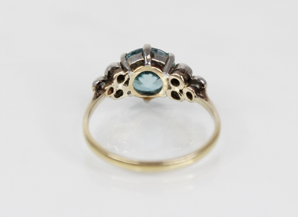 A zircon and diamond ring, the central round mixed cut blue zircon (measuring 8.65mm diameter), - Image 4 of 8