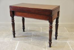 A Victorian mahogany folding bagatelle table, the rectangular top opening to a baize lined playing