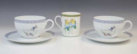 A Hermes porcelain mug in the Toucan pattern, late 20th century, printed Hermes marks to base, 9.5cm