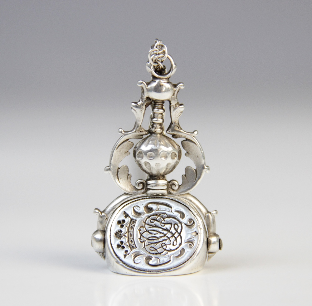A 19th century silver coloured three-sided swivel fob pendant, each oval face with an engraved - Image 2 of 3