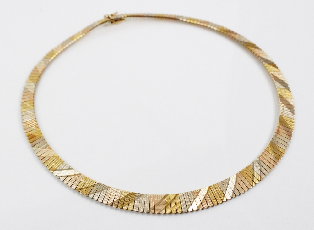 An 18ct three-colour gold collarette, comprising alternating sections of rose gold, yellow gold