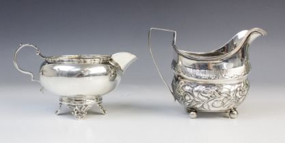 A George III silver milk jug, maker's marks for 'ID', London 1808, of oval baluster form on four