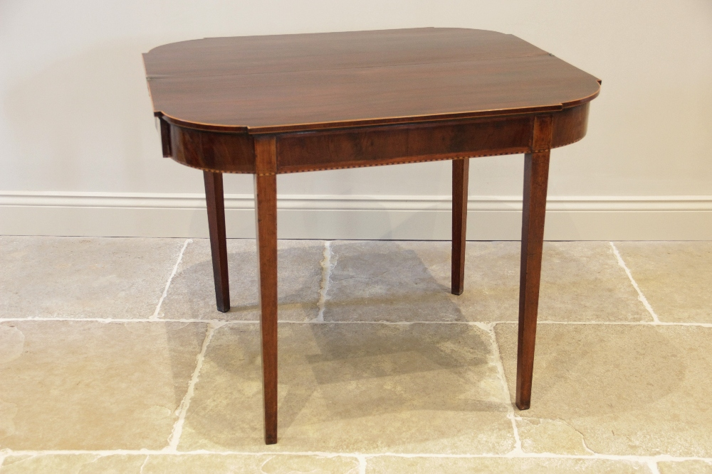 A George III mahogany folding tea table, the shaped top with inlaid satinwood stringing to the edge, - Image 2 of 3